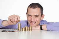 Mature man with coins and euro notes