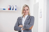 Germany, Bavaria, Munich, Businesswoman in office, smiling, portrait