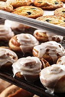 Sticky Buns and Cookies on Bakery Shelves
