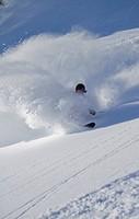 Austria, Tyrol, Kitzbuehel, Mature man skiing