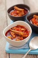 Okra pods in tomato sauce