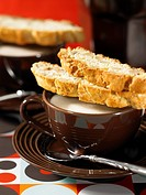 Walnut biscotti on a cappuccino cup