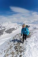 A women jogging on high Alpine mountains