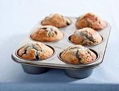 Six Homemade Blueberry Muffins Still in Baking Tin