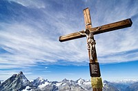 A cross of Christ marks the top of Klein Matterhorn near from Zermatt village in the Swiss Alps