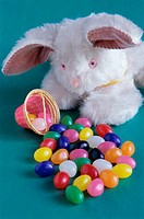 Easter bunny with an Easter basket and jellybeans