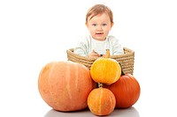 Young baby girl with pumpkins