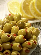 Close_up of a plate full of olives