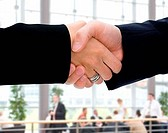 Close_up of a handshake between two businesspeople