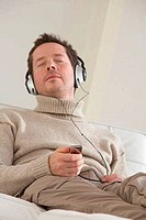 Mature man listening to music