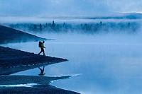 Man walking at the lakeside, Truckee, California, USA