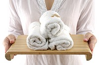 Woman holding towels in a tray