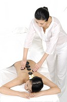 Young woman getting lastone therapy