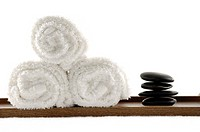 Close_up of pebbles with towels