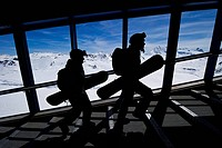 Two snowboarders on heir way to the lifts