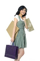 Woman carrying shopping bags and smiling