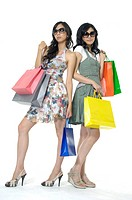 Women carrying shopping bags and smirking (thumbnail)