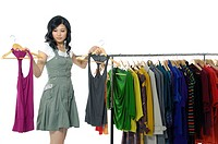 Woman selecting tops in a clothing store