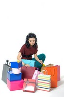 Woman depressed while looking at shopping bags