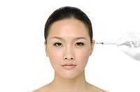 Injection of botox on female temple - female portrait (thumbnail)