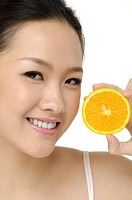 Pretty smiling woman with orange