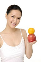 beautiful asian female portrait with representation of fruits _ isolated
