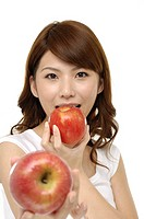 Pretty smiling woman with apples