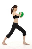 Woman stretching using an exercise ball