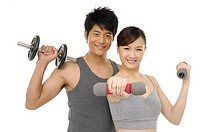 young couple holding Dumbbell