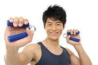 A man squeezing a forearm exercise tool