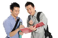 Male university students studying together