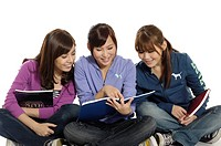 Three female university students studying together
