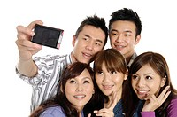 Group of university students taking a picture of themselves with a digital camera