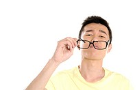 Male university student holding eyeglasses