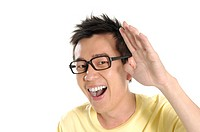 Male university student gesturing and laughing