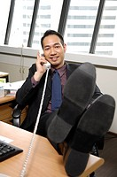 Businessman talking on the telephone in an office