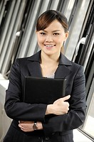 Businesswoman holding a file and smiling