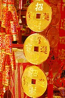 Chinese coins and Chinese firecrackers at a market stall, Dihua Street, Taipei, Taiwan