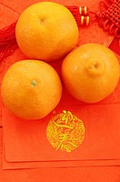 Oranges on red envelopes at a market stall, Dihua Street, Taipei, Taiwan