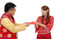 Man giving a red envelope to his girlfriend