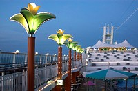 Illuminating evening lamps on the deck of Norwegian Dawn Cruise Ship