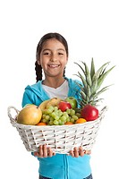 Little girl carrying a fruit basket on white background