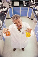 High angle view of a man holding two flasks in a laboratory