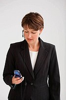 Close_up of a businesswoman talking on a mobile phone using a hands free device