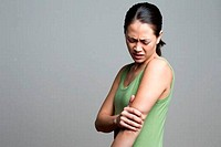 Young woman suffering from elbow pain