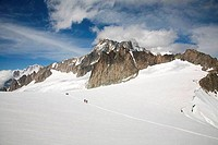 Hikers on a snow covered mountain, Mer De Glace, Mont Blanc, France