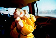 Two brothers wrestling in a car