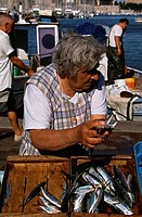 Mature woman standing in a fish market, Marseille, Provence_Alpes_Cote d´Azur, France