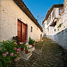 A typical narrow cobbled alleyway with ottoman period houses in the Mangalemi district of Berat in central Albania