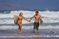 A couple having fun in the surf